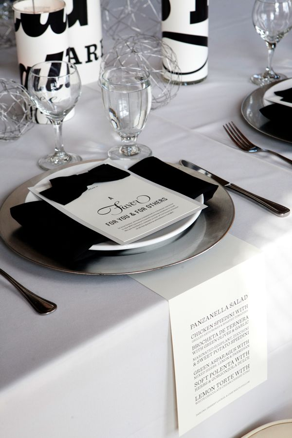 Black and white table with bow tied to favor cards + menus
