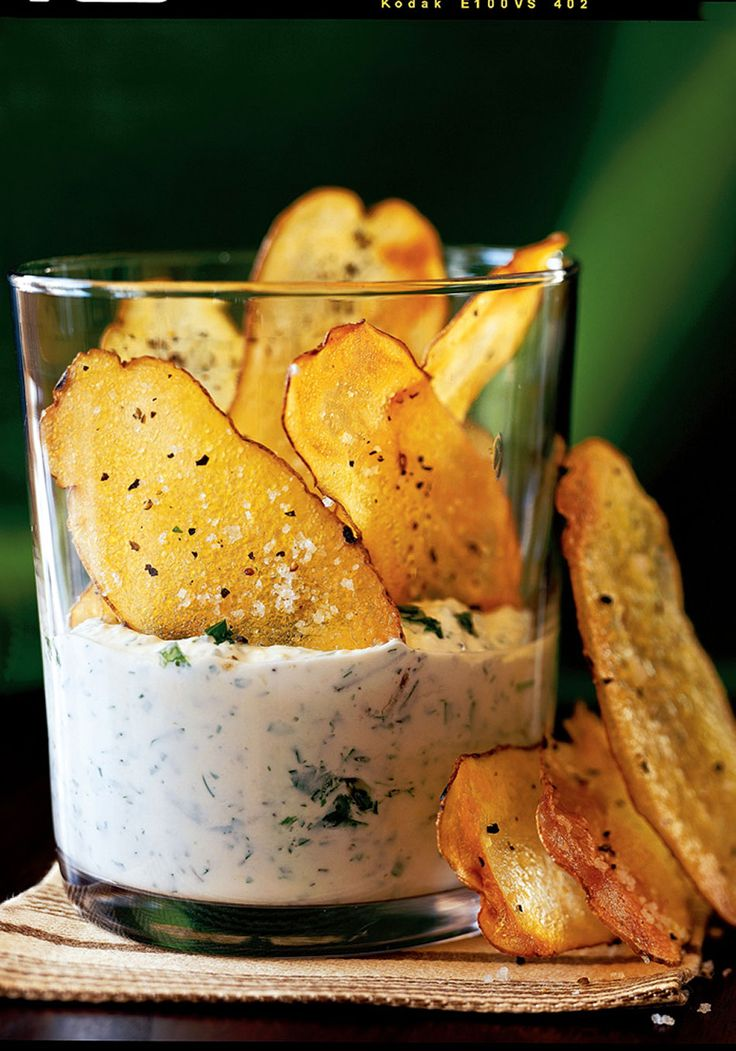 The secret is finally out of the bag: Homemade potato chips baked with a hint of olive oil have a crisper snap and are simply more potatoey tasting than store-bought. When they're served with a phenomenal Parmesan cheese, herb, and garlic dip, we guarantee no one will eat just one.