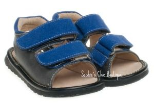 Gray and Blue Squeaky Sandal-Black and Blue Squeaky Sandal, Hailey- Metallic Pink Bow Squeaky Sandal,Posh squeakers, squeakers, Squeaky shoes at a discount, Toddler squeaky shoes, children's squeaky shoes, squeaky shoes for children, black squeaky shoes, sophie's chic boutique, little blue lamb squeaky shoes, squeaky shoe boutique, squeaky shoes wholesale, squeaker shoes, squeaky toddler shoes, squeaky baby shoes, sophie's boutique, squeaky shoes in Utah, little blue lamb squeaky shoes…