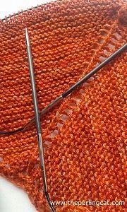 Shawl in progress. Garter body, edge to be decided. Coolree yarn.