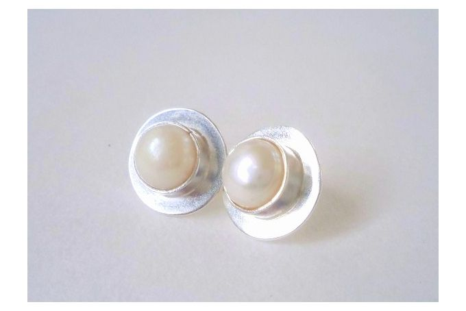 Sterling silver and freshwater pearl earrings by Secrets Unearthed Jewellery on http://hellopretty.co.za