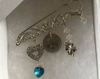 Silver plated kilt pin with charms to represent the wedding tradition, Something Old, Something New, Something Borrowed, Something Blue, which comes from an Old English rhyme about the four objects needed to secure wedded happiness - £7.50 plus p&p