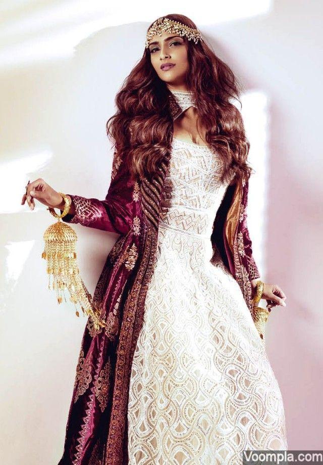 Sonam Kapoor in a burgundy JJ Valaya jacket worn over a white Abu Jani Sandeep Khosla anarkali. Her jewellery includes a Ra Abta kalira, ring by Jaipur Jewels and a matha patti by Amrapali. via Voompla.com