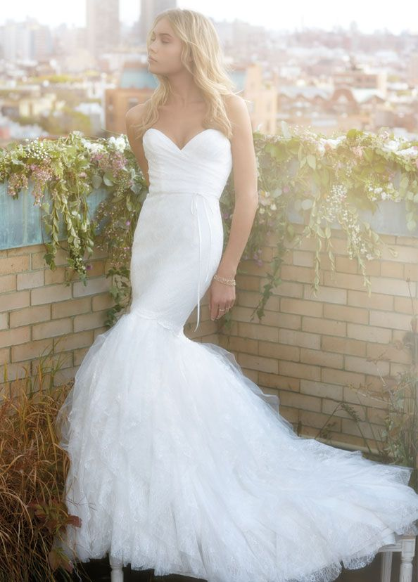 Ivory chantilly lace trumpet bridal gown with cascading lace and tulle skirt. Strapless sweetheart neckline, draped bodice and natural waist with ribbon detail. Bridal Gowns, Wedding Dresses from Ti Adora by Alvina Valenta - JLM Couture - Bridal Style 7400 by JLM Couture, Inc.