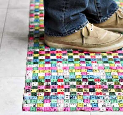 Measuring Tape Floor Mat: This colorful floor mat woven from used tape measures is an alternative to regular black or grey rubber floor coverings.
