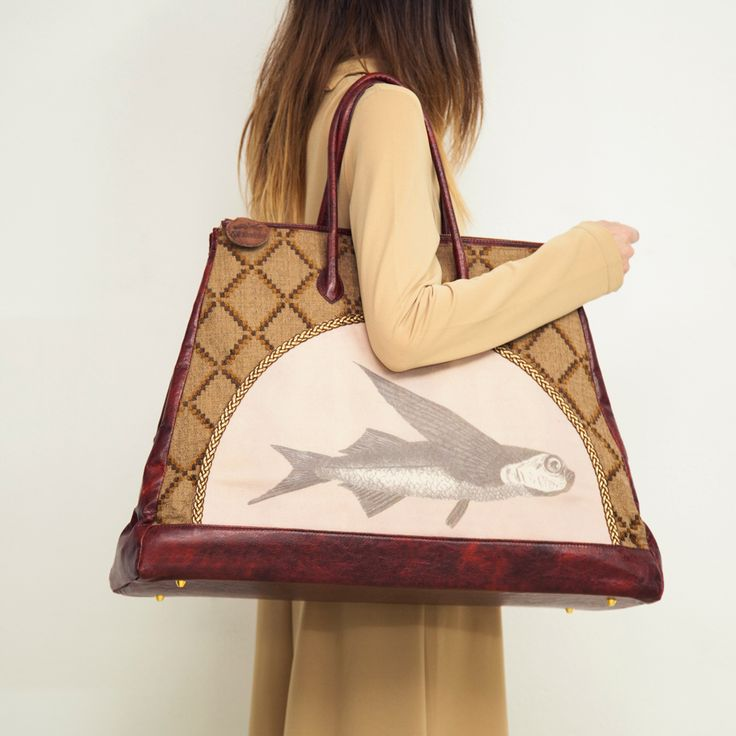 Handcrafted large weekend bag - intricate stitch detailing and a fish on the front! If you like this get it here http://themanysides.com/products/cousteau-weekend-bag