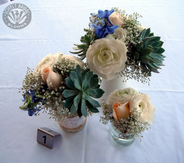 mini table posies of succulents, roses, ranunculus, delphiniums and babies breath