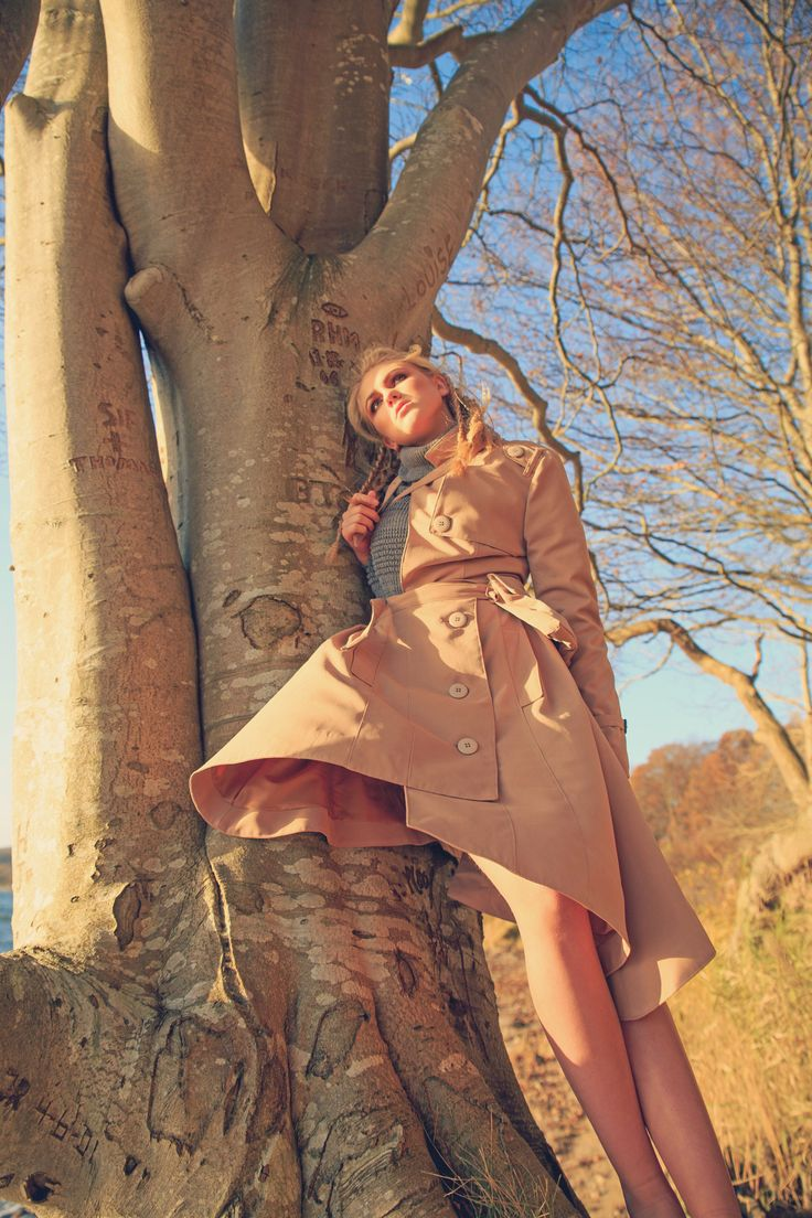 Her real name is Ditte Straarup. This Picture was publiced in OBSCURAE magazine volume 21. (December 2015)  I love this Picture because of the way Dittes long legs compliments the big tree. And how the coat (Designed by Ida Amby Nørgaard) blowing perfectly in the Wind. + people WHO have etched their names in the tree and her facial expression...