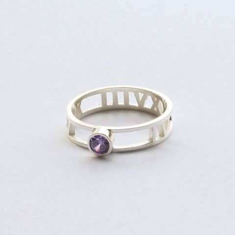 Roman Numeral Ring with Birth Stone Adorned with the stone of your birth month, this roman numeral ring is personalized in a subtle but meaningful way. Just give us the date and we will convert to roman numbers for you. You can wear one with the birthstone of yourself or your nearest and dearest's. It also make perfects sense as a gift for mothers or couples.