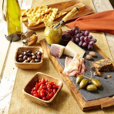 Napa Slate Cheese Board Say cheese in the most elegant of ways with our slate and wood cheese board. With its sophisticated design, all you need to add is wine and good company.