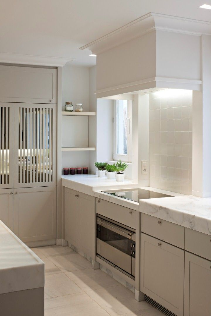 sleek, modern, classic kitchen.  thick marble, hood profile, marble kickplate