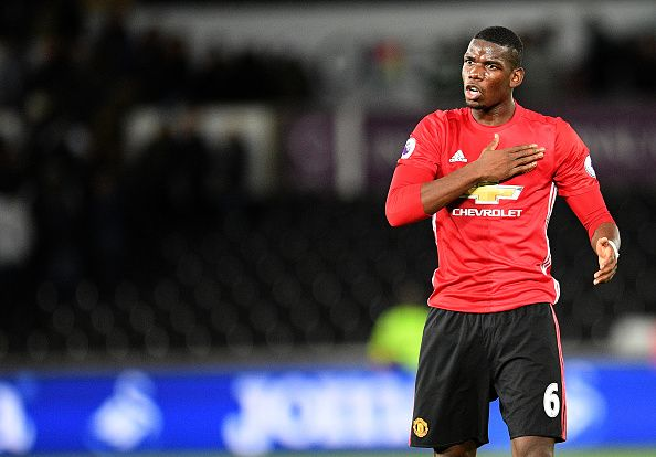 Manchester United's Paul Pogba celebrates at full time infront of the Manchester United fans during the Premier League match between Swansea City and...