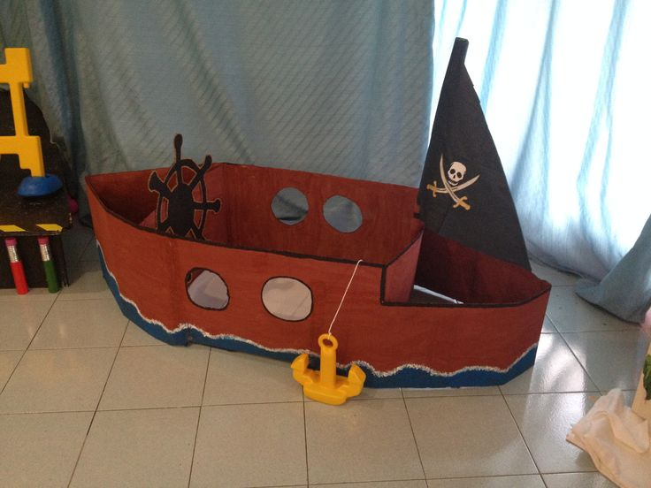 A pirate boat made out of cardboard (carton).   As I work(ed) at a mini club in a hotel, I desided to make something extra for the kids that come on holidays!
