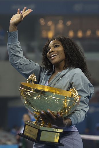 Serena Williams of U.S. holds her winning trophy and waves to her fans after the final of the China Open tennis tournament at the National Tennis Stadium in Beijing, China, Sunday, Oct. 6, 2013. Williams defeated Jelena Jankovic of Serbia 6-2, 6-2. (AP Photo)