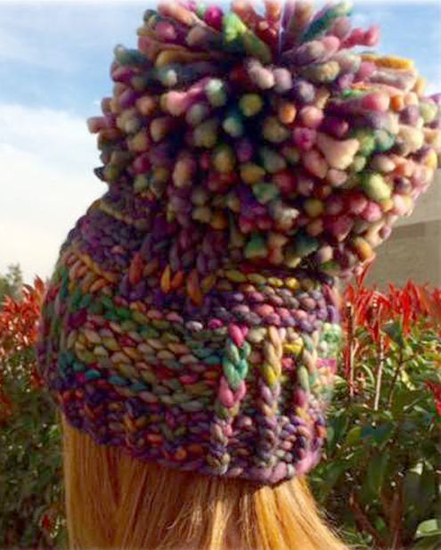 Free Knitting Pattern for A Pompom With a Hat - This aptly named pattern has an eyecatching giant pompom with a beanie attached. Easy knit in super bulky yarn. The designer reports that it just takes a couple of hours. You can knit the hat without the huge pompom (or a smaller pompom) and then it will take one skein of the recommended yarn. Designed byMolly Conroy