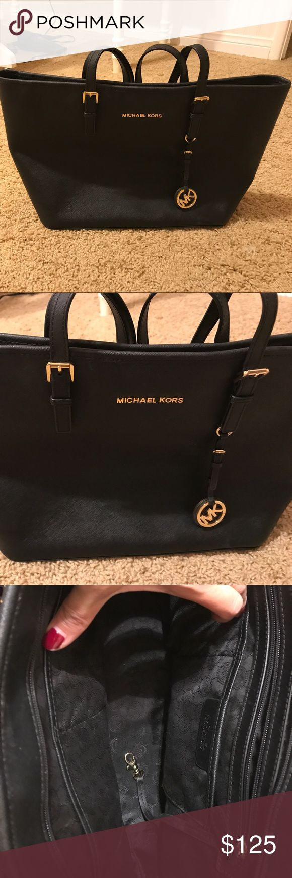 Genuine Michael Kors handbag Excellent condition black MK purse.  Gold MK detail. Zipper at the top   16X10 in size. Perfect size purse. Bags Shoulder Bags