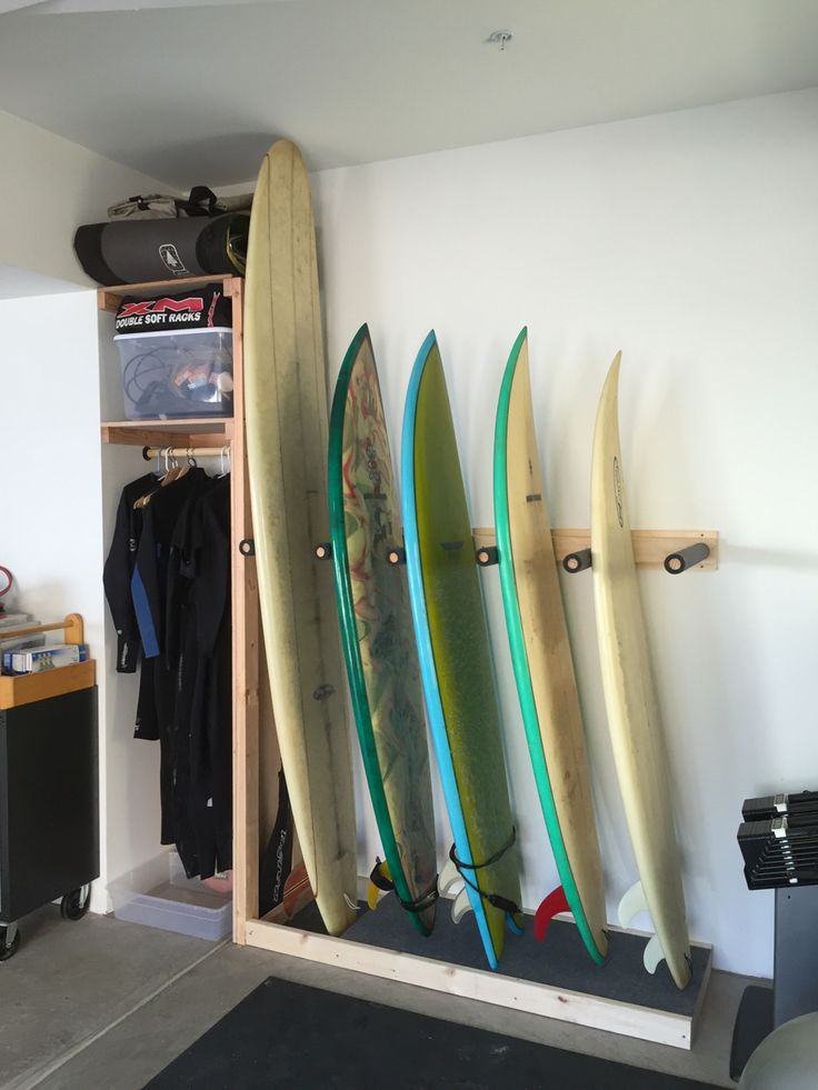 Surf rack build with a shelf cubby for wetsuits & accessories