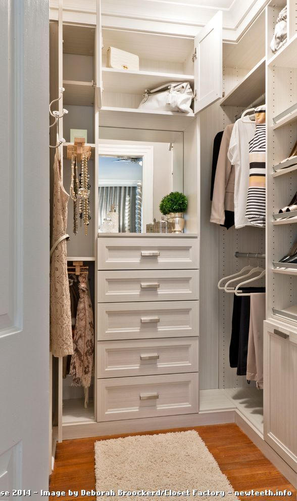Compact walk-in closet with drawers and vanity mirror (DC Design House)