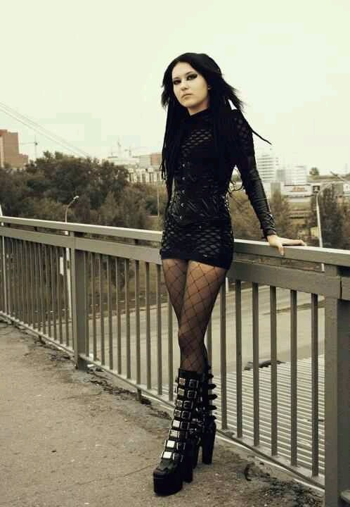 I like the dress & the fishnets but not the boots, I'd wear a different type of platform or high heeled boot instead.