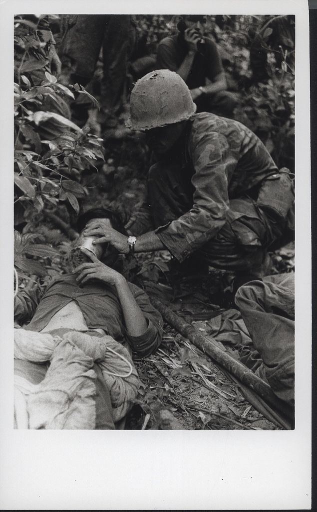 https://flic.kr/p/LwZXfL | Corpsman Treats a Wounded NVA Soldier, 1969…