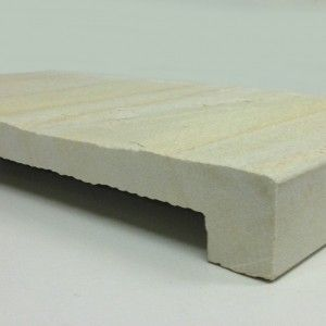 Pool Coping Tiles in Golden Sands Natural Split Sandstone. Drop Face Pool Coping stocked in 600x400x40/20mm. We have matching pool paving. Other sizes available by request.  Rebated / Drop Down pool coping tiles or step treads stocked in 600x400x40/20. Other sizes available by request or can be cut from existing tiles.