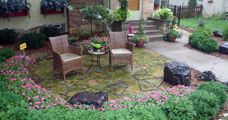 small front yard patios | Front yard natural stone patio with Northshore sitting boulders ...