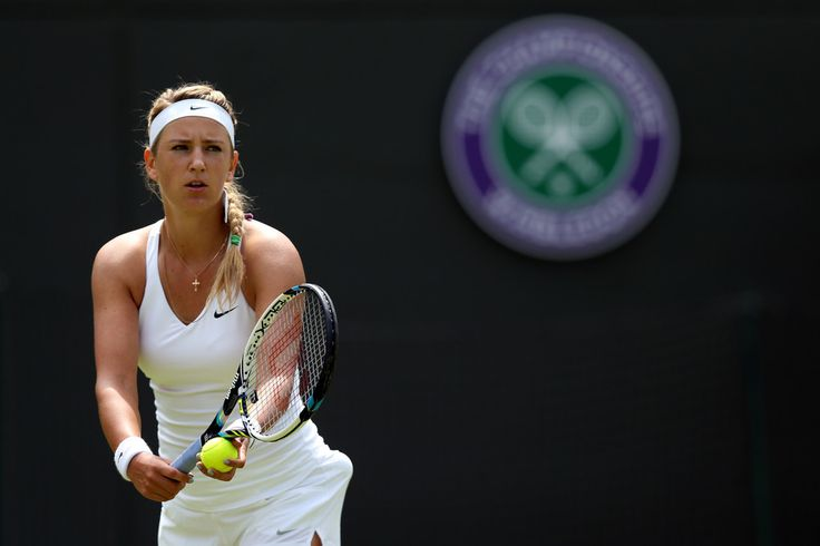 Victoria Azarenka Photos: Wimbledon: Day 1. Victoria Azarenka of Belarus serves during her Ladies' Singles first round match against Mirjana Lucic-Baroni on day one of the Wimbledon Lawn Tennis Championships at the All England Lawn Tennis and Croquet Club at Wimbledon on June 23, 2014 in London, England.