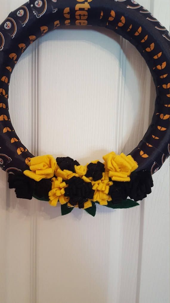 Here we go Steelers! Here we go! This Pittsburgh Steelers wreath is made with ribbon and felt. The flowers are all hand made and there is a ribbon attached for hanging. The wreath measures approximately 12 inches in diameter. It is recommended that it be hung in a sheltered area behind a storm door or indoors.