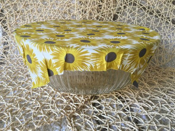 Reusable and washable beeswax wrap with a Yellow Sunflower design. Great eco-friendly substitute for plastic wrap! Use to wrap and store bread,