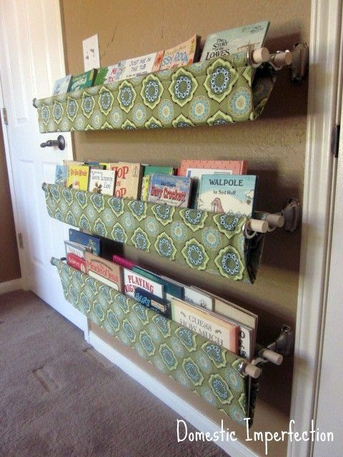 Use double curtain rod brackets to hang custom made book slings for easy, visible book storage