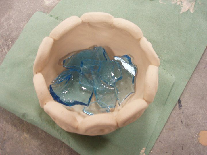 Ceramic pot before firing - the glass melted and looks lovely.