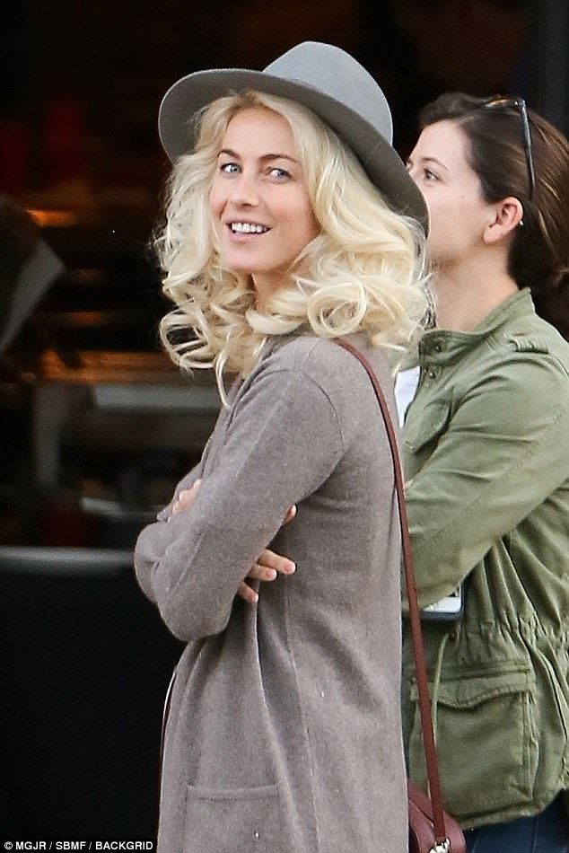 Blast from the past! Julianne Hough sported a mass of golden curls as she became Joe Weider's glamorous wife Betty on the set of her new movie in Birmingham, Alabama on Thursday