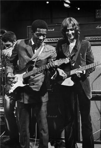 One of today's b'day celebrants Buddy Guy with Eric Clapton in 1969 -- Dick Waterman photo