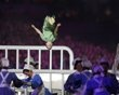 Children bounce on trampoline beds during the opening ceremony of the London 2012 Olympic Games at the Olympic Stadium