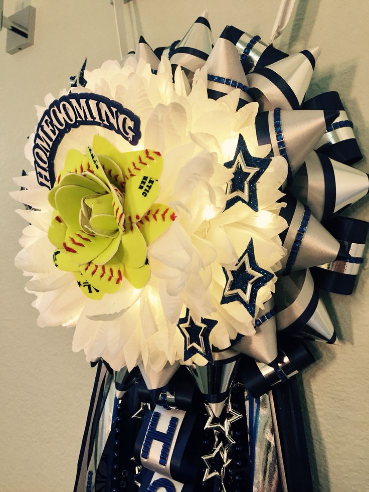 Homecoming mum with a handmade softball flower centerpiece and LED lights.