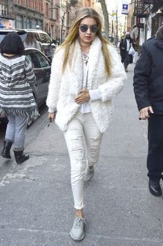 64 affordable celebrity style looks: Gigi Hadid goes for a winter white look in her Express shag coat.