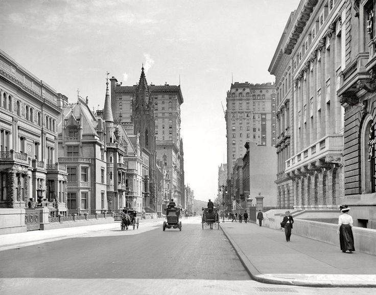 Taken from the middle of the intersection Fifth Avenue and 51st street in New York City, the photograph above shows the streets of New York in 1908 with Central Park visible in the background.