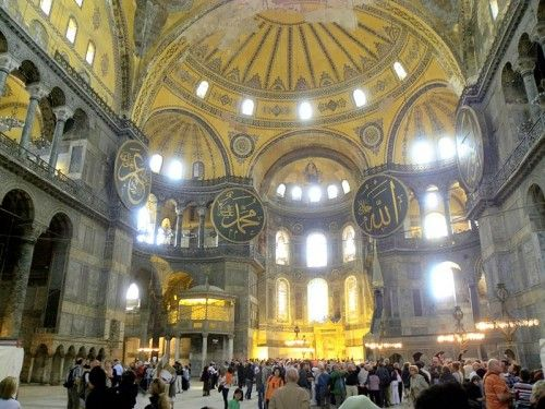 """Hagia Sophia, Istanbul. built as a church by Isidore of Miletus and Anthemius of Tralles who were chosen as architects by the Byzantine Emperor Justinian. Hagia Sophia (meaning """"holy wisdom"""") was completed in 537 BCE and was transformed into a mosque in 1453 CE when the Ottomans conquered the city."""