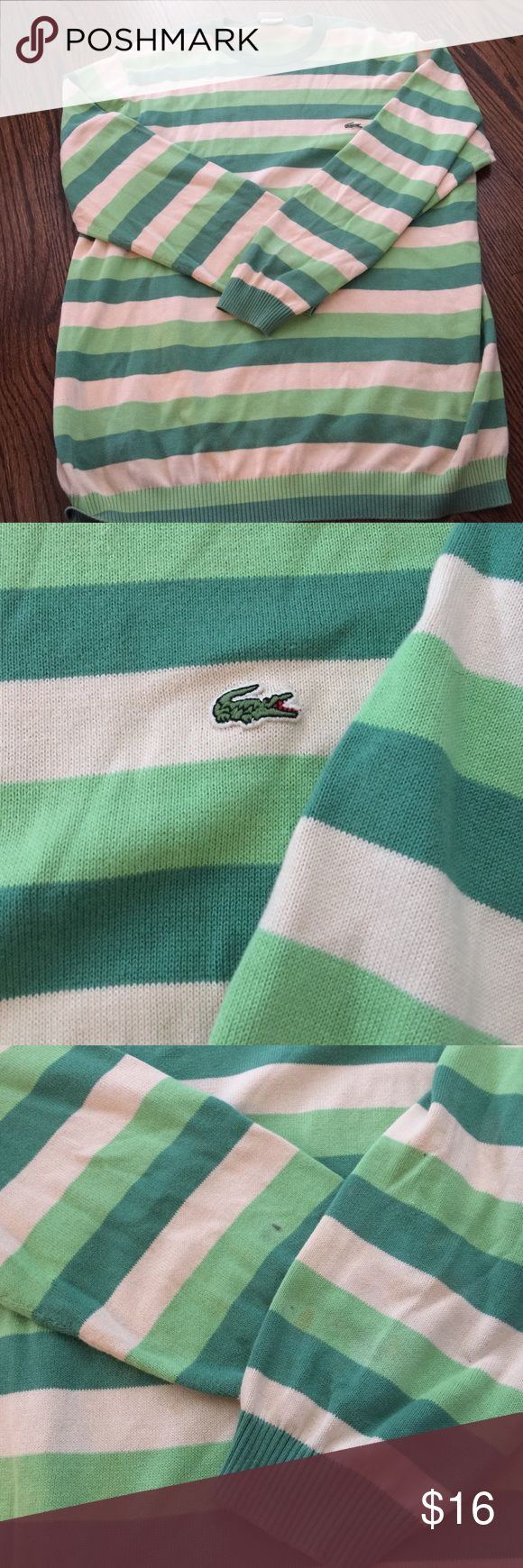 Green stripes Lacoste sweater Multi green stripe Lacoste sweater.  Has a few rice size stains and a small discoloration as shown in last picture.  No major wear and or tears.  Great long comfy sweater for women or medium sized for men Lacoste Sweaters Crewneck