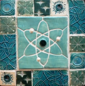 This is way cool, atomic tile.  I would do my bathroom in it today if I could find something like it.