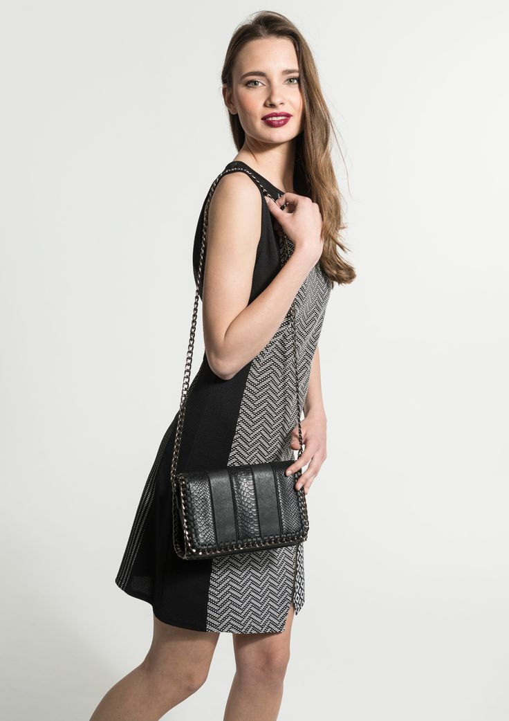 Cross-body black bag with chain strap and braided detail on the flap.
