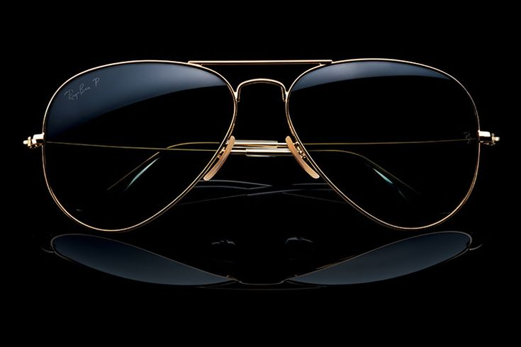 """Ray Ban has done it again by reintroducing the classic """"Aviator Frames"""" but this time, in material that has consumers thinking twice about these simple shades. These glasses are made out of 18K gold which gives them a sleek but bright finish. These glasses have a price tag of $3,200 possibly making you think twice about purchasing. - Trevor S."""