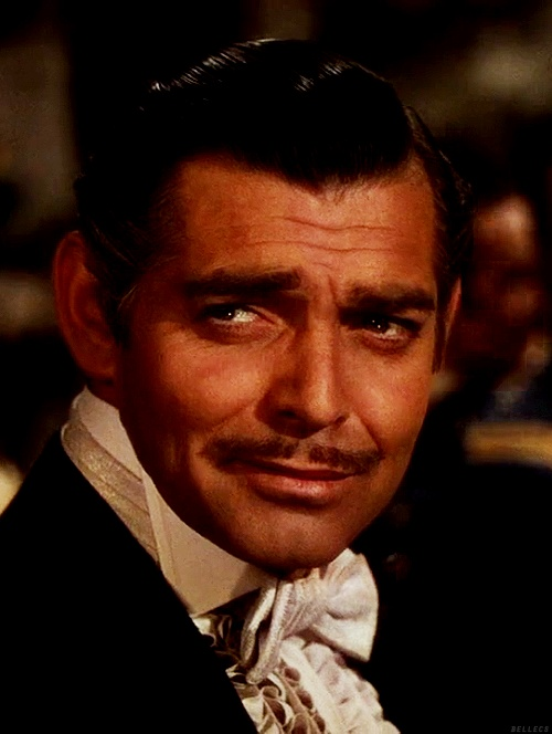 Clark Gable as Captain Rhett Butler, a visitor from Charleston, S.C. at the Wilkes plantation