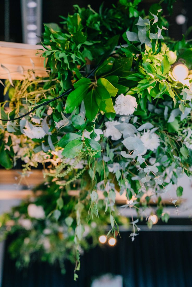 Love the white weaved into the green hanging bouquets.  Adorn Event Styling@Tailrace Centre