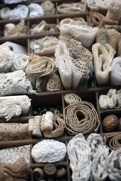 rolls of lace and vintage trim
