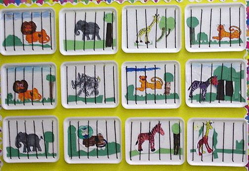 "zoo: use styrofoam meat trays and ""sew"" strings to be the cage bars. Add the animals....you can even string them together to make it a train"