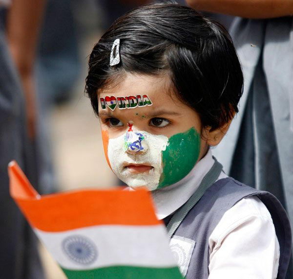 A schoolgirl, with her face painted in colours of the Indian national flag, holds a flag during Independent Day celebrations inside her school in the western Indian city of Ahmedabad. (REUTERS)  http://www.emirates247.com/india-independence-day-1.279131