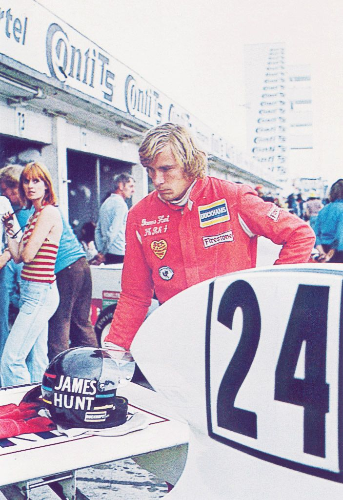 James Hunt, somehow oblivious to the smokin' hot dolly bird just behind him...