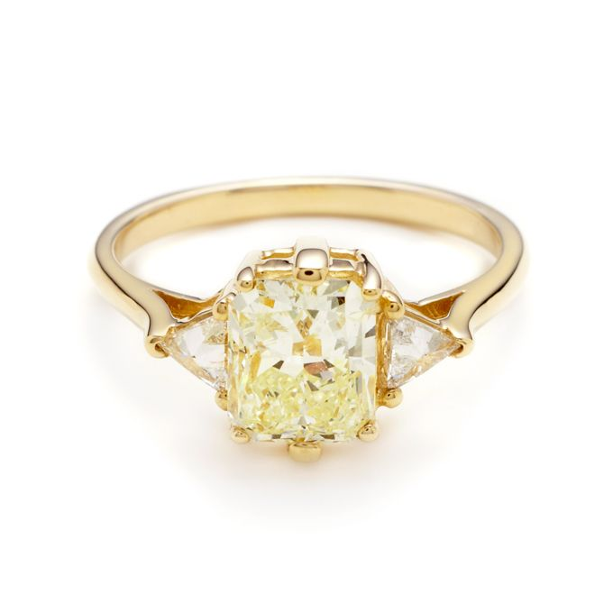 """Brides.com: 36 Yellow Gold Engagement Rings for Every Type of Bride. """"Bea"""" 1.70 carat light yellow color radiant cut diamond center 1.98ctw set in 14kt yellow gold"""