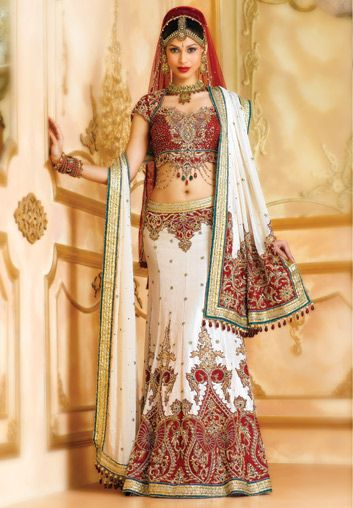 BW81 Off-white & Maroon Lehenga PANETAR A traditional off-white and maroon four piece heavily embroidered panetar. An off-white brocade maroon net dupatta draped on the head and a striped georgette dupatta.